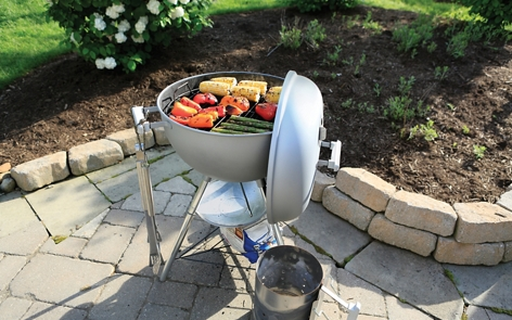 Spray painting a backyard grill