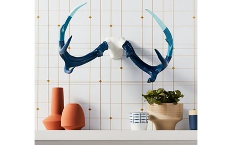 Spray painted antlers on a wall