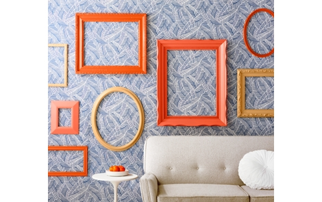 Spray painted picture frames on a wall