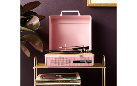 Spray painted record player on a spray painted stand